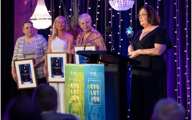Angie's Domestic Duties founder Angela Brown accepts her Champion Employer award. Photo: Photox